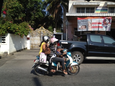 Family on scooter in Phuket, Thailand